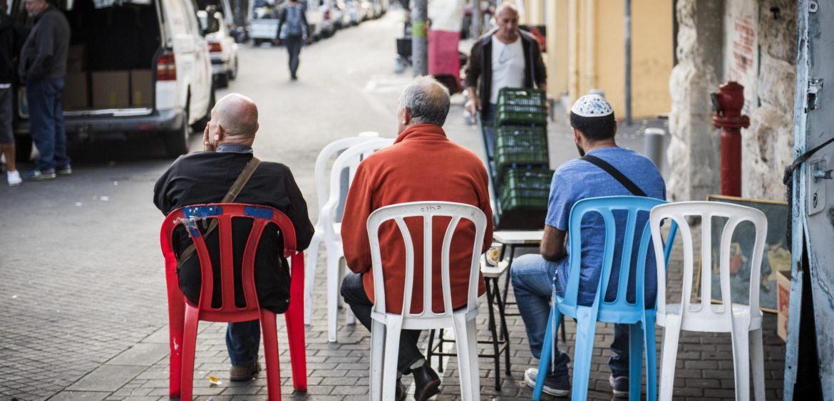 Men gazing over Jaffa's Shuk HaPishpushim, or Flea Market